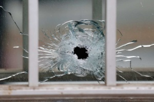 A bullet's impact is seen on a window at the scene after a shooting at the Paris offices of Charlie Hebdo, a satirical newspaper,